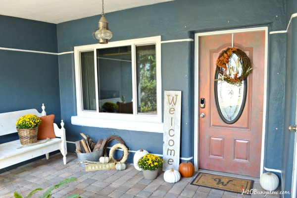 Front porch with bench, yellow mums, pumpkins and DIY large wood welcome sign
