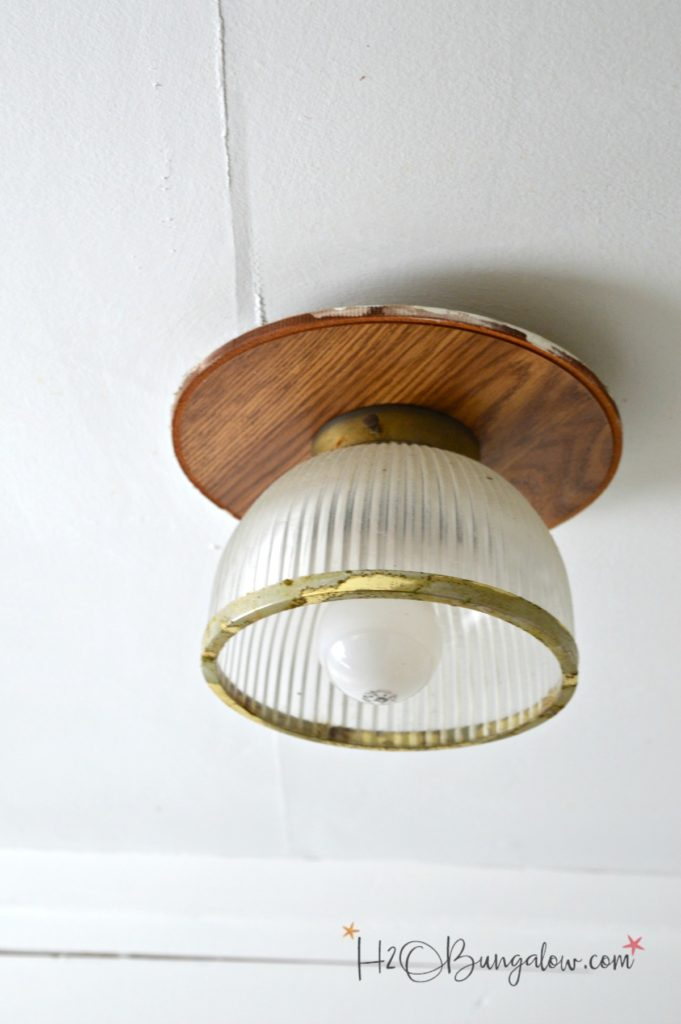 before picture of ceiling light fixture with glass globe and brass accents and would ceiling mount