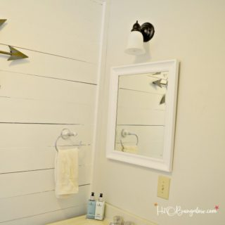 DIY tutorial on how to paint a metal light fixture and change the finish without taking it down from the wall or ceiling. What to use and how to do it. Save big budget dollars with this DIY project.
