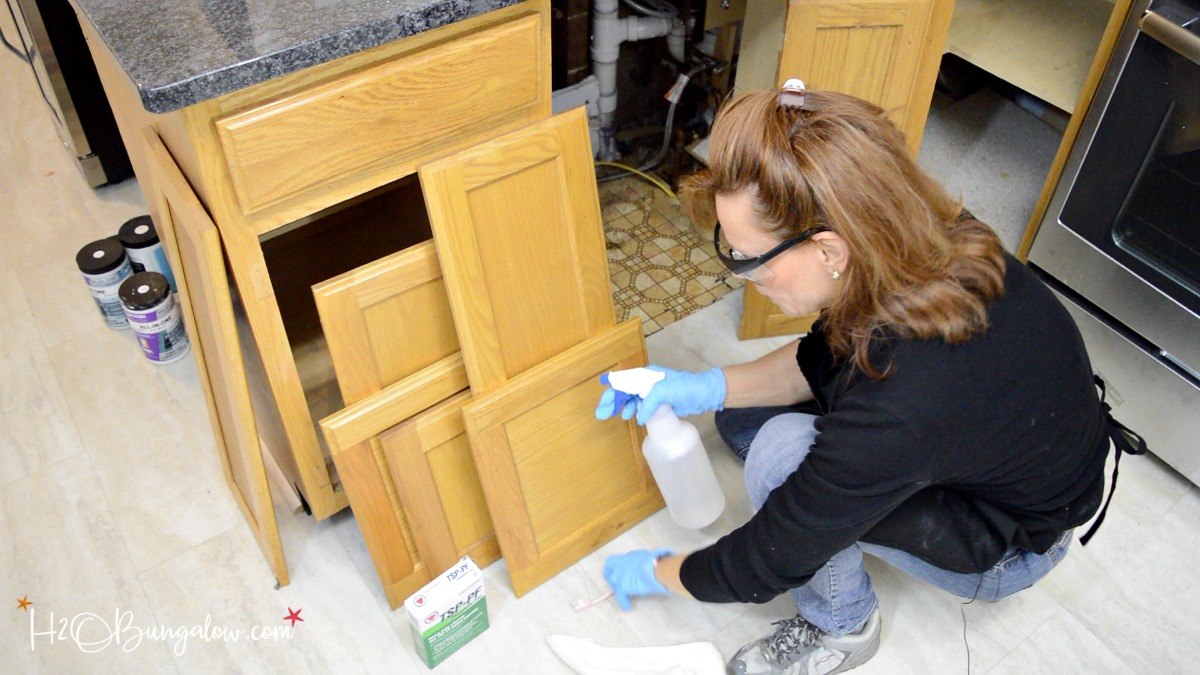 clean the front and back of doors cabinet bases basically youre cleaning any surface area that will be painted an old toothbrush is a great tool to get