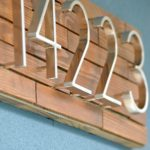 Add instant curb appeal. Easy modern DIY Horizontal Wood Slat Address Plaque Tutorial. Use only a jigsaw, glue and outdoor mounting tape. Drill optional to float letters.