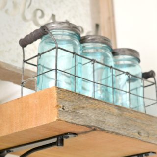 DIY reclaimed wood kitchen shelves made from wood scraps add character and texture to a modern farmhouse. Simple tips for an upscale DIY kitchen project