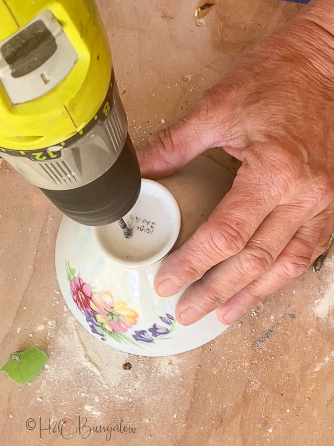 drilling a drain hole in bottom of tea cup