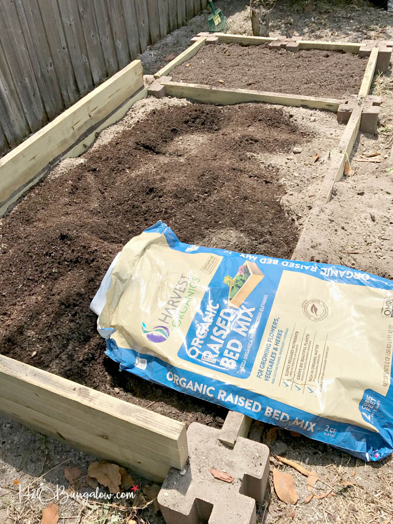 raised garden bed with organic soil bag