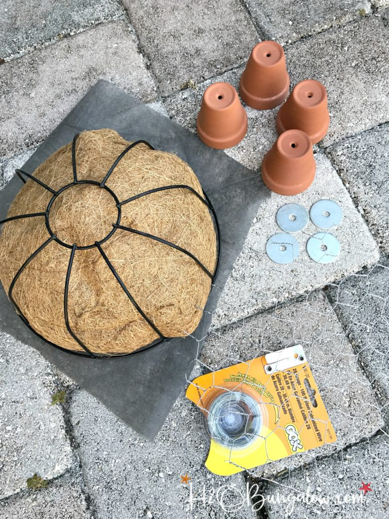 four small clay pits, chicken wire, wire plant basket to make turtle topiary