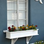 How to build a flower box planter tutorial for the new woodworker. Easy to follow building plans. Make this window box and get instant curb appeal.
