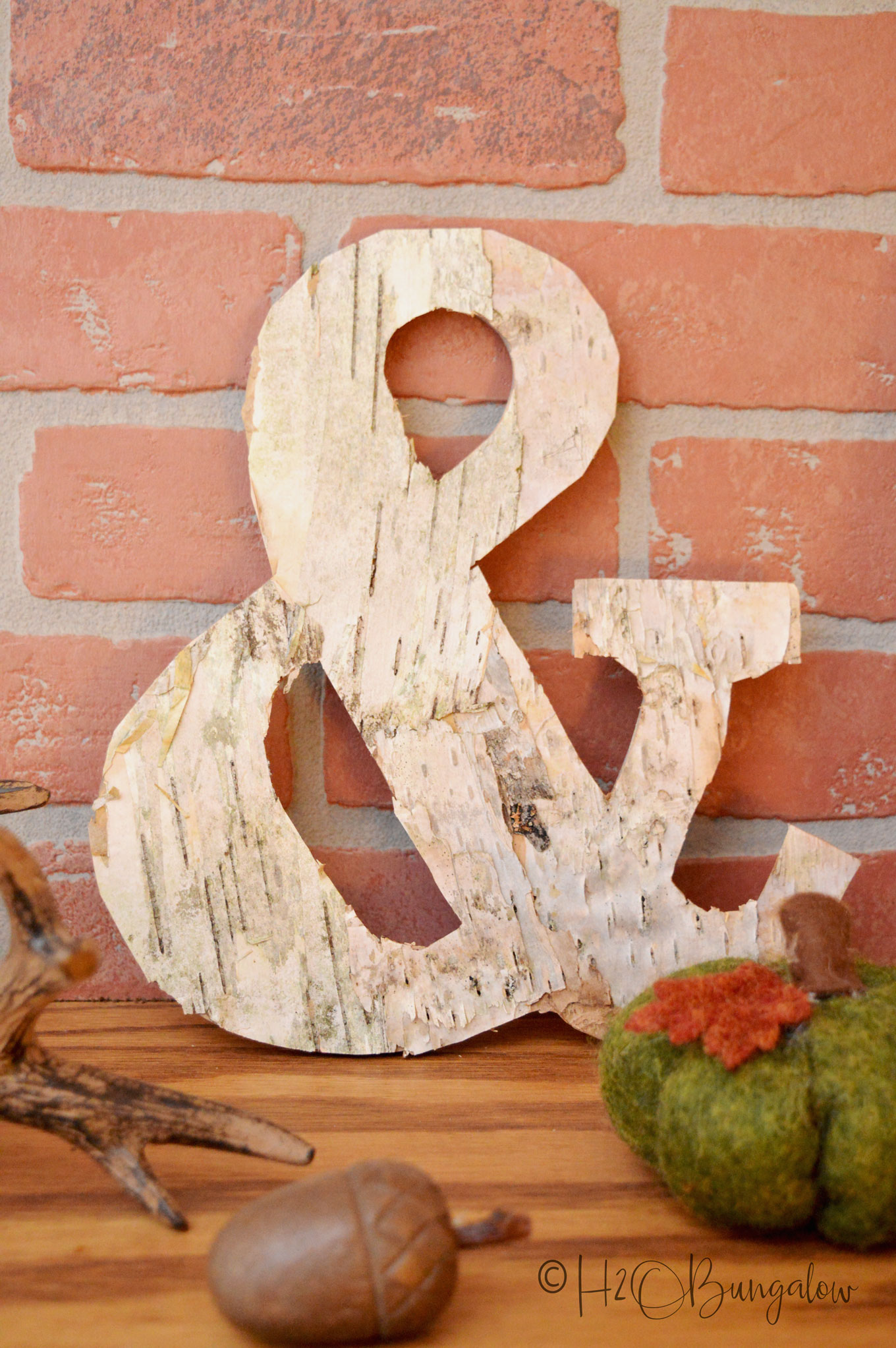 Bark craft idea to make a DIY birch bark picture frame. Easy tutorial to follow works on any flat photo frame or large letter. Birch bark craft gift idea.