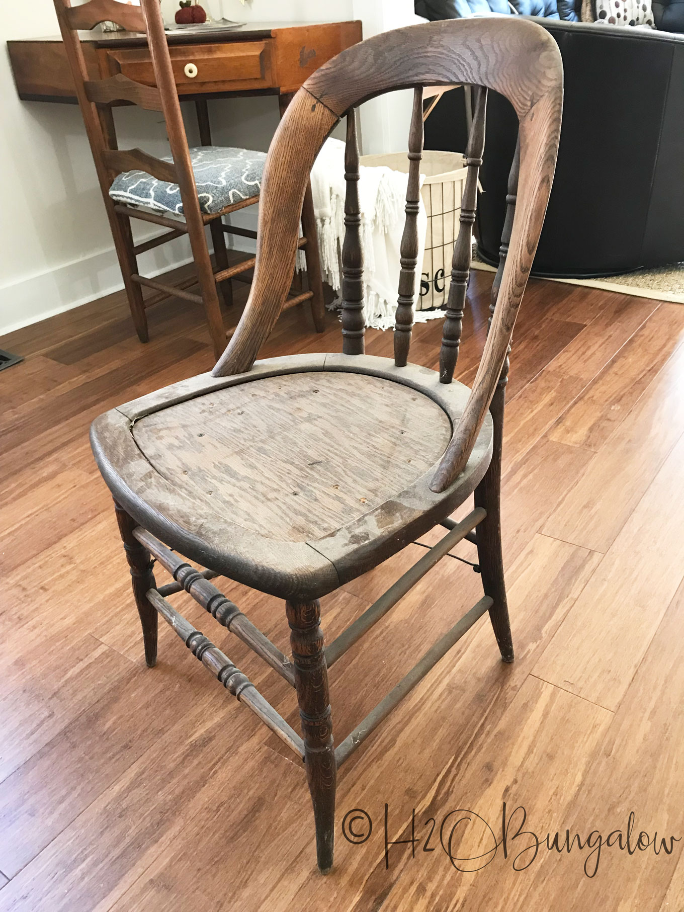 Tutorial for a cowhide chair makeover using real cowhide for the chair seat. Make this a fabulous accent chair with faux animal print or a cowhide.