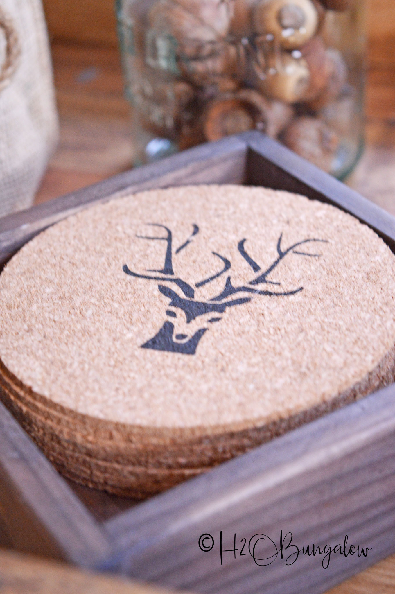 Closeup of deer antler stenciled cork coaster