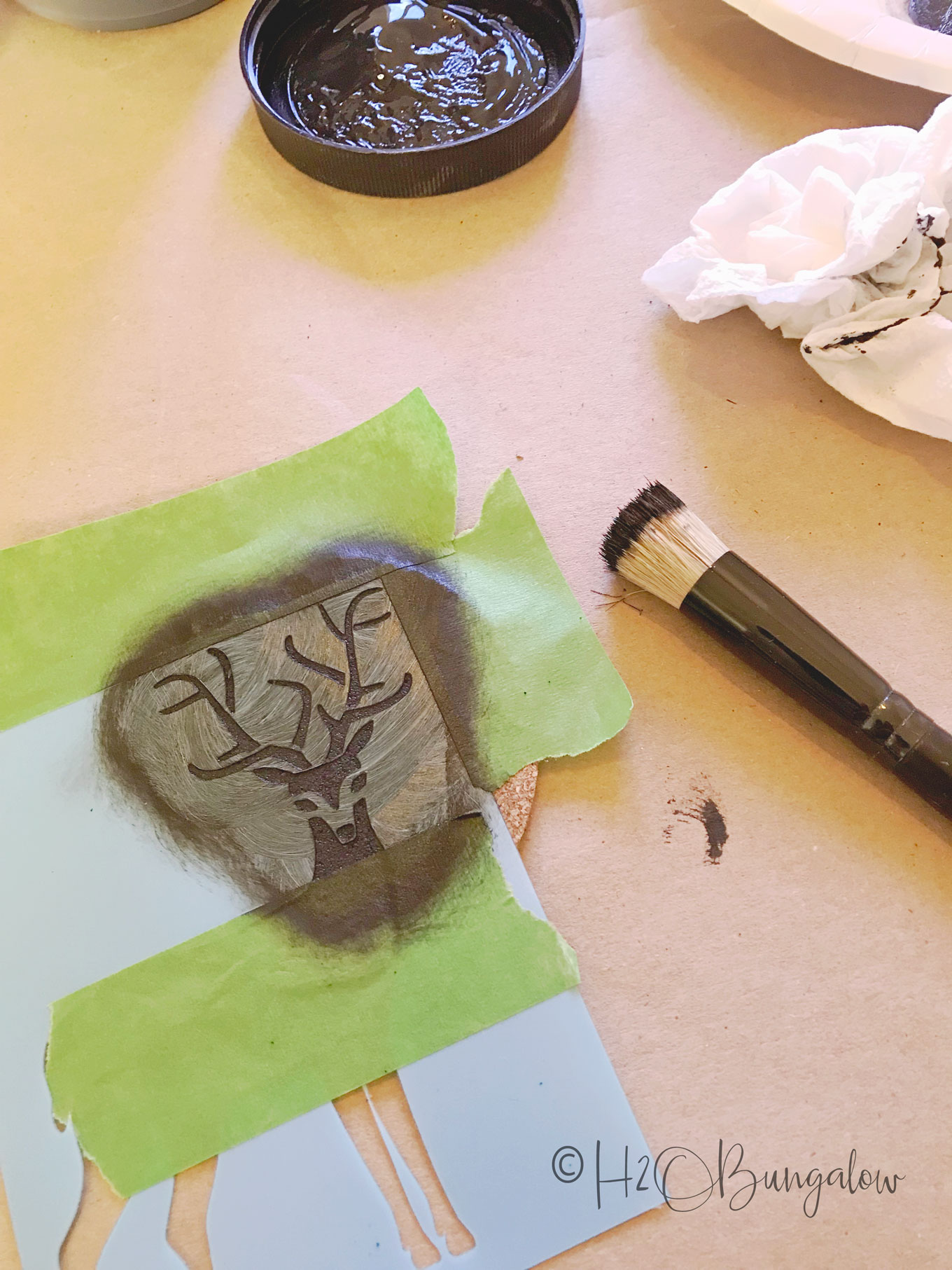 Deer stencil with small paintbrush