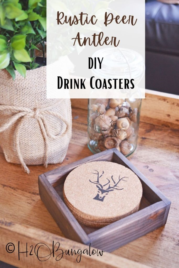 Rustic deer antler coasters sitting on table with plant . Image to pin to Pinterest