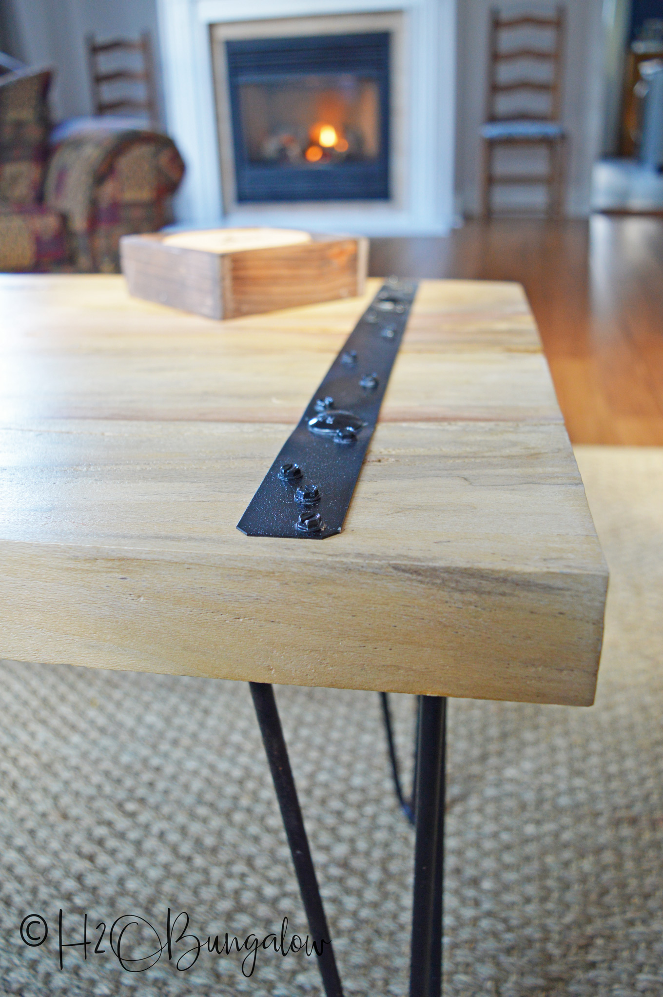 I'm loving the simplicity of this DIY rustic coffee table. I used two wide planks for the table top, but you could easily make a coffee table, or end tables with several wood boards or planks. Modify these DIY plans a little and it's an easy build requiring few tools and not a lot of time.