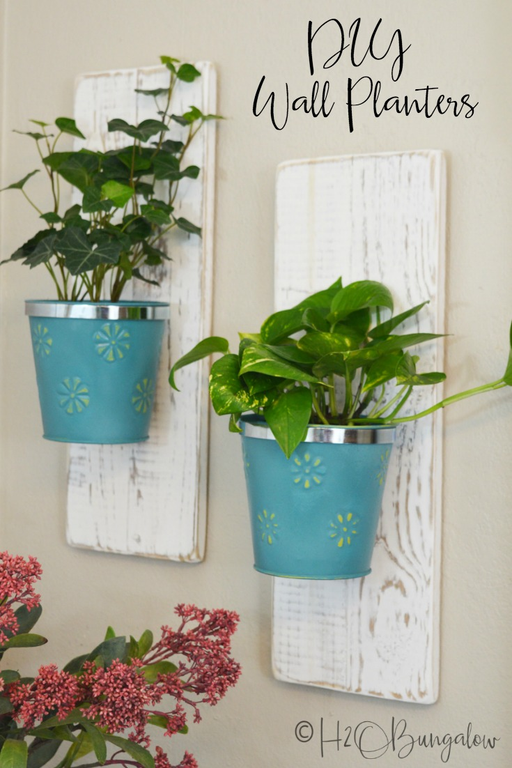 Easy tutorial for DIY wall hanging planters using dollar store items. I made a set of three hanging wall planters for my vine plants to cascade down. This is a great way to easily hang plants on walls. Hang your plants on walls, fences, outside walls or mount several on a board for a living wall.