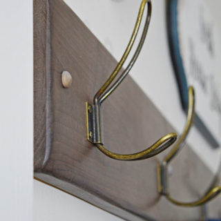 Instructions to make a quality DIY vintage hook coat rack that looks like it came from a designer store. Making a coat rack with hooks is simple,. I share how to add the extra touches that make it a wow DIY project. This coatrack fits perfectly in a modern rustic or modern farmhouse home.