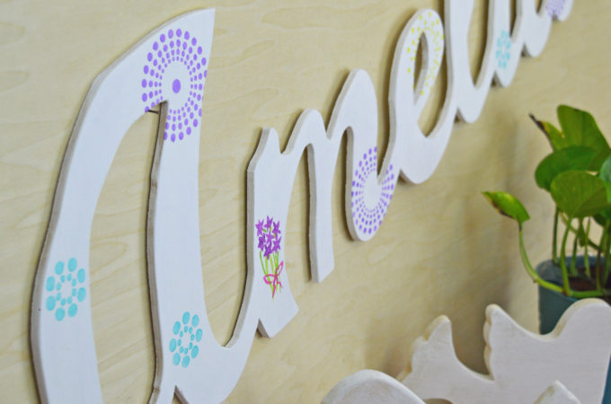 """Tutorial to make a DIY large wood name cut out. Easy project to make using a 1/4"""" piece of scrap plywood, a jigsaw and a palm sander. I've cut large script letters out of wood before and have a good tutorial which I link to below. This post shares more tips for making clean cuts when cutting out words with a jigsaw."""