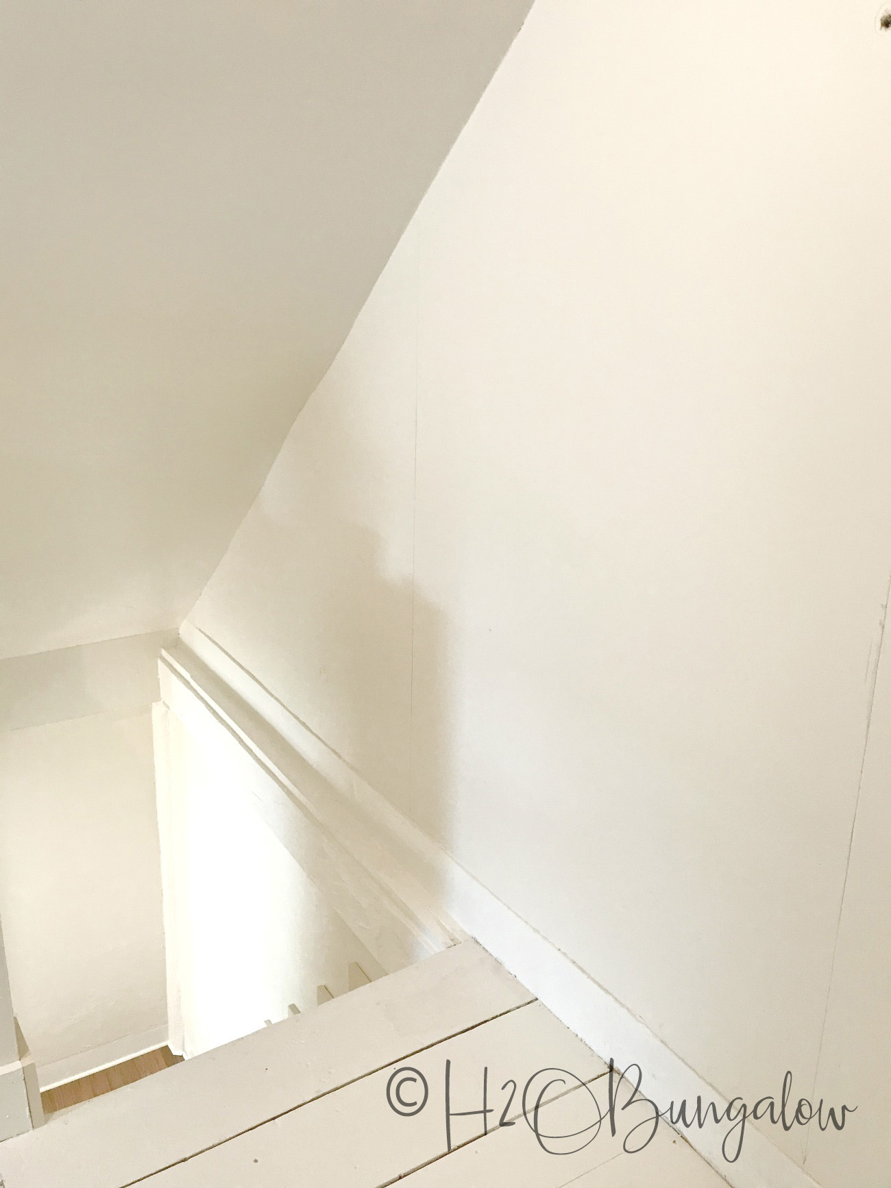 stairwell wall painted white