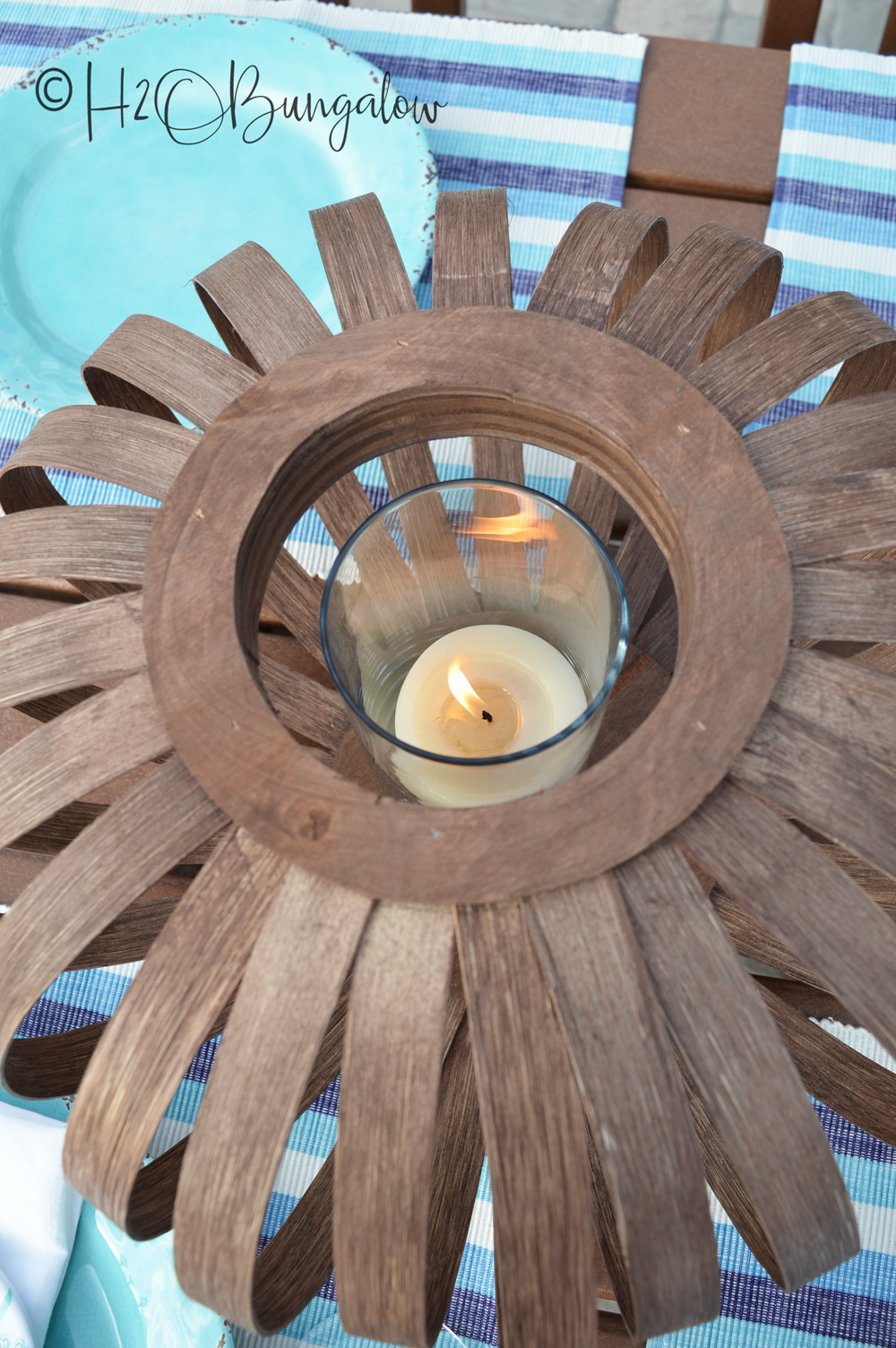 Make an upscale DIY wooden lantern that's versatile enough to use indoors or outside. Pop in a tall glass candle holder and candle or use an LED candle, either one fit's nicely with the wide top opening. Follow this easy tutorial to make a wooden lantern or set of wooden decorative lanterns for this years summer decor.