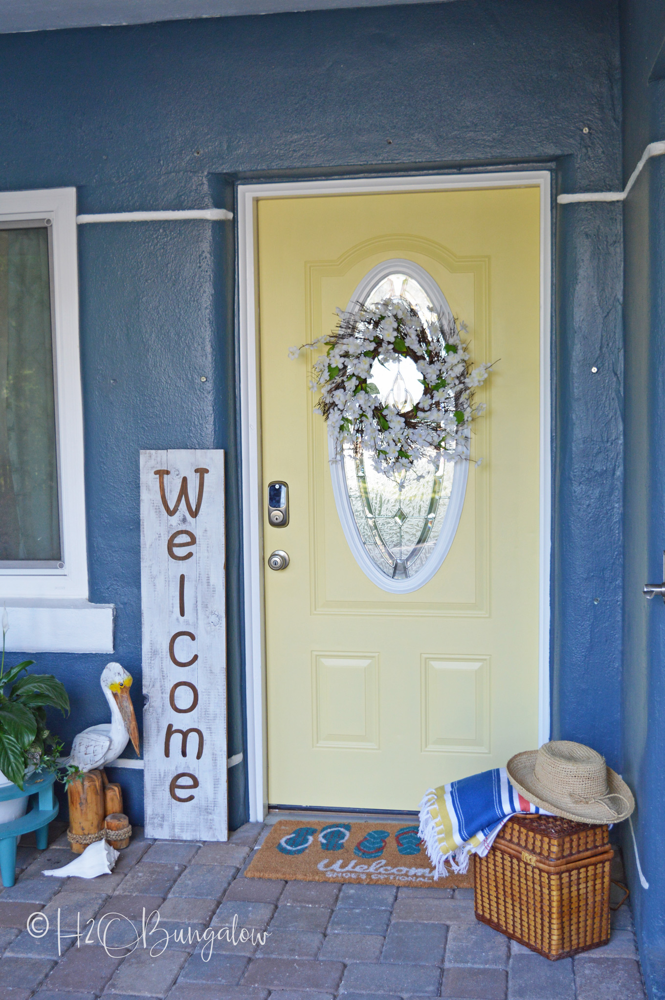 I can't believe I finally bit the bullet and changed out the entry to a yellow painted front door, Guys!  Thinking about painting your front door yellow or maybe even another color? See my tutorial on how to paint a front door, pick out a color and links to my most popular home improvement painting tutorials