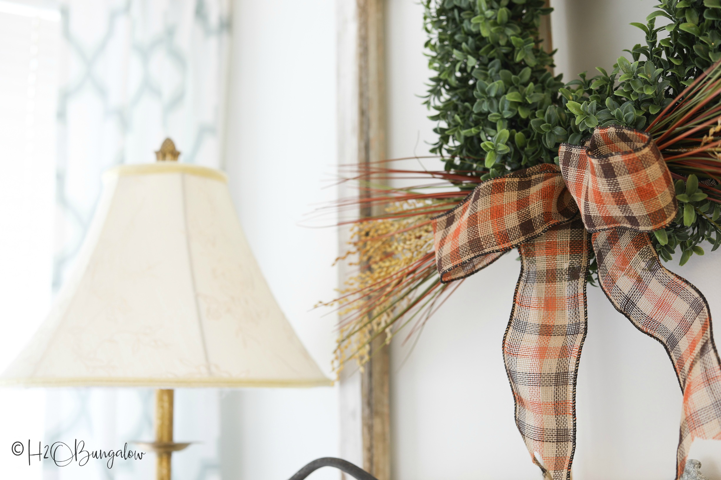 Make this easy fall boxwood wreath following my simple video tutorial. Quick and pretty fall decor for your front door or fireplace mantel.