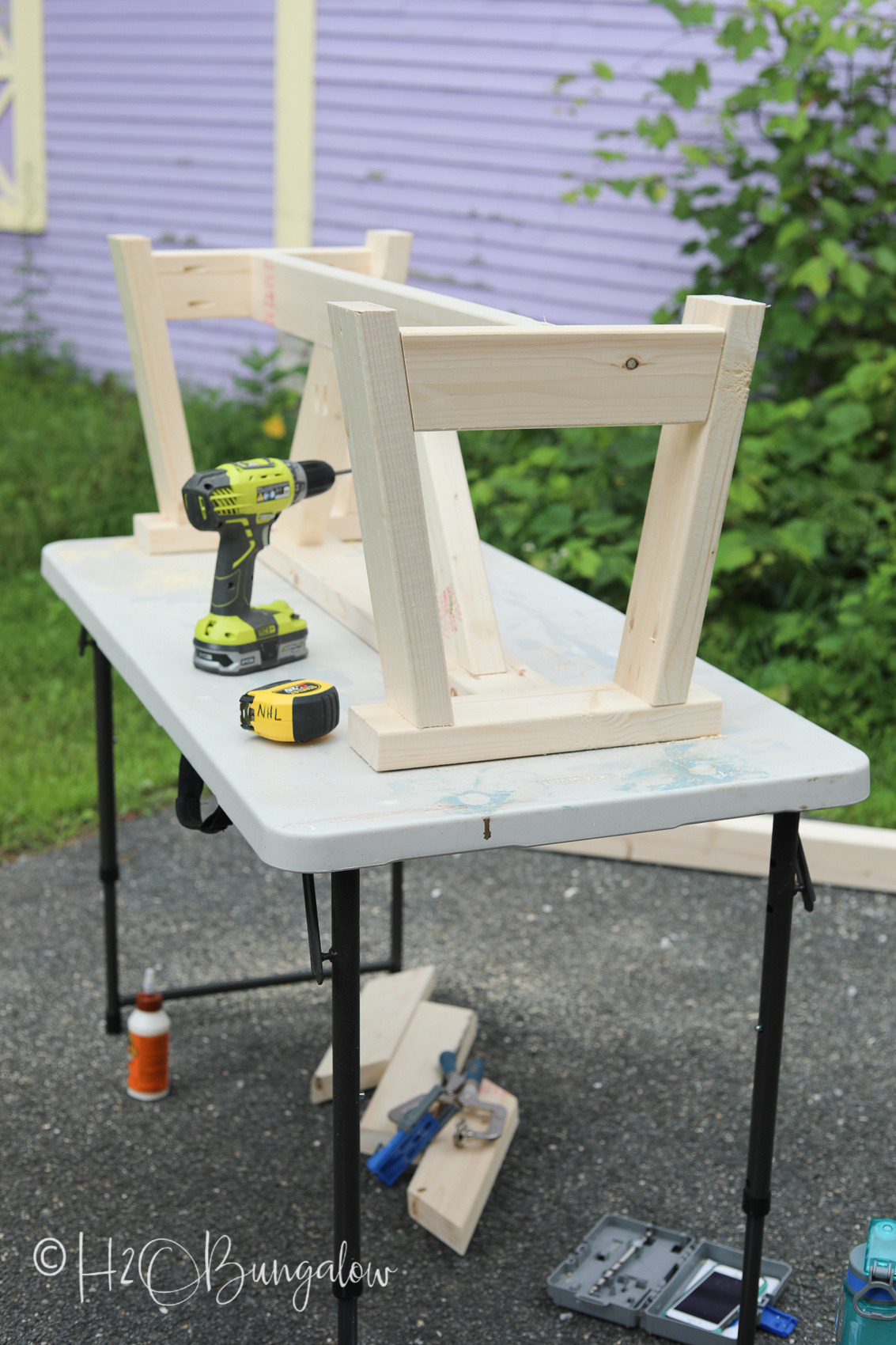Attaching bench spreaders for a DIY modern rustic wood bench tutorial