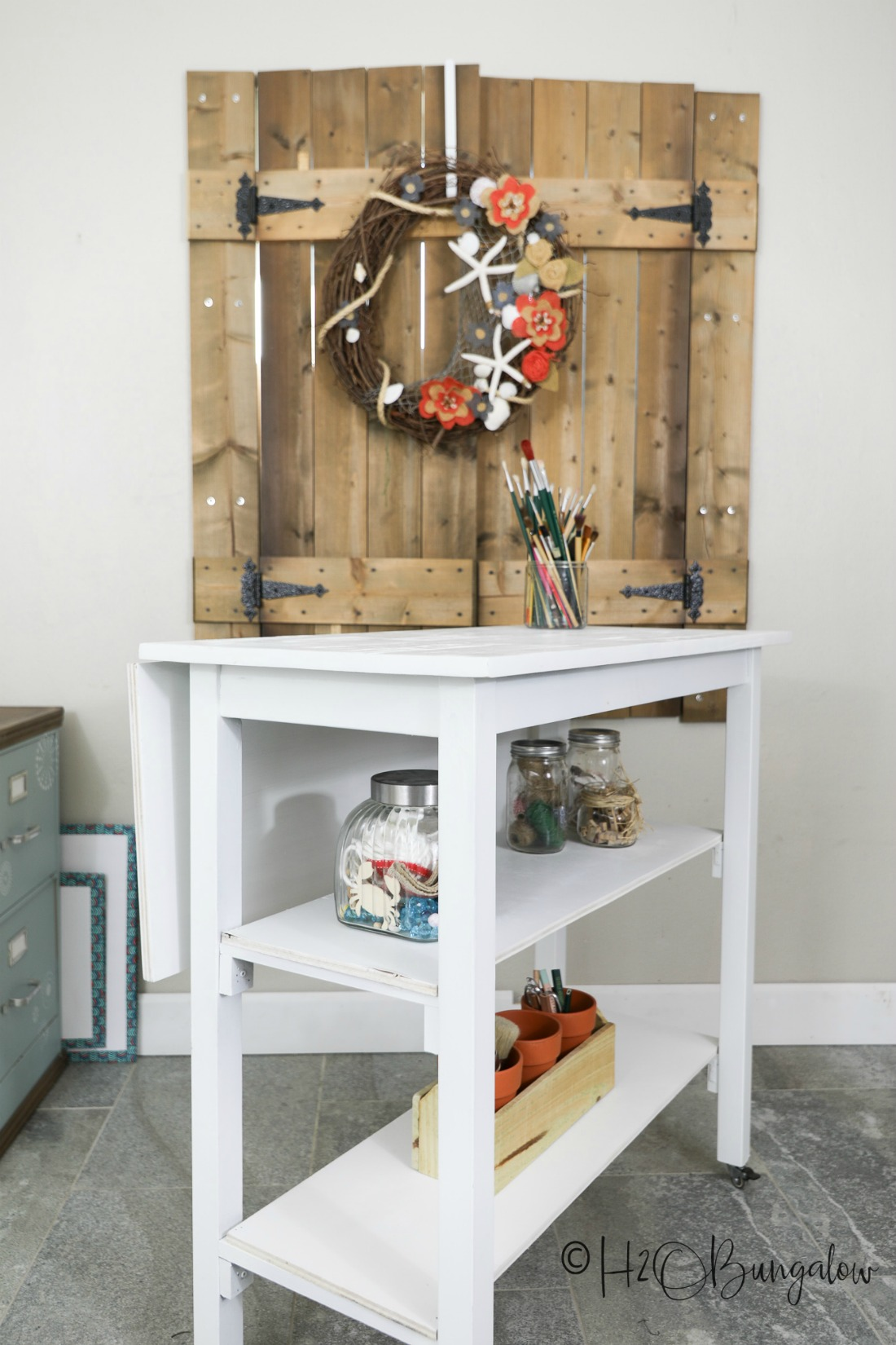 DIY rolling worktable with shelves added