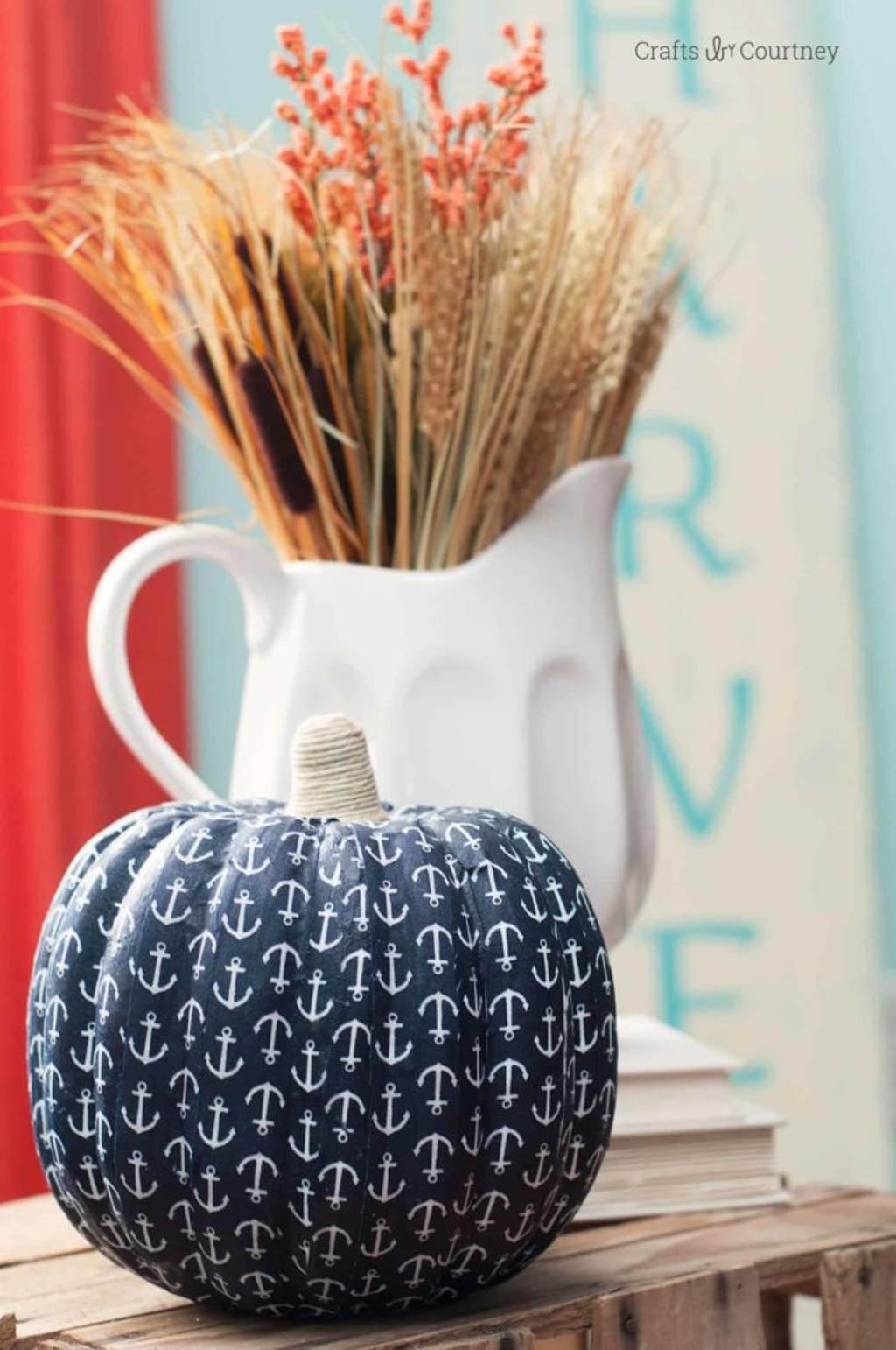 coastal fall decor idea using pumpkin covered in boat anchor motif fabric