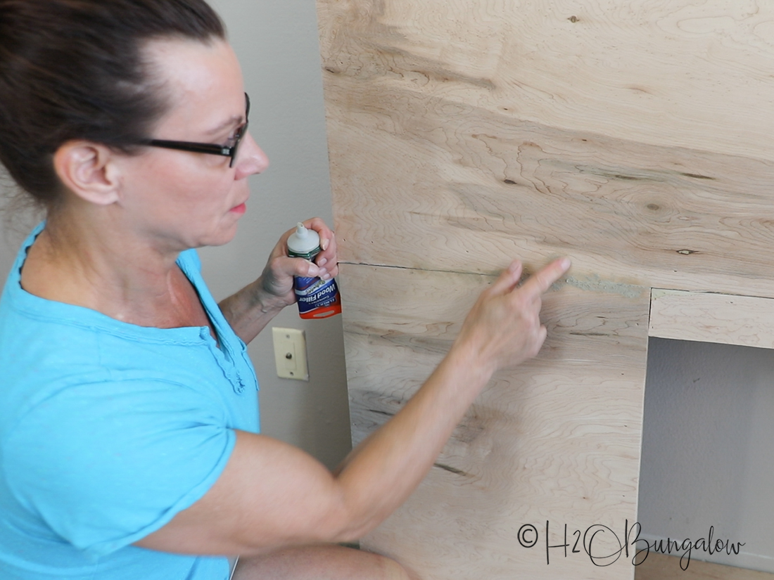 caulking wood frame for DIY fireplace