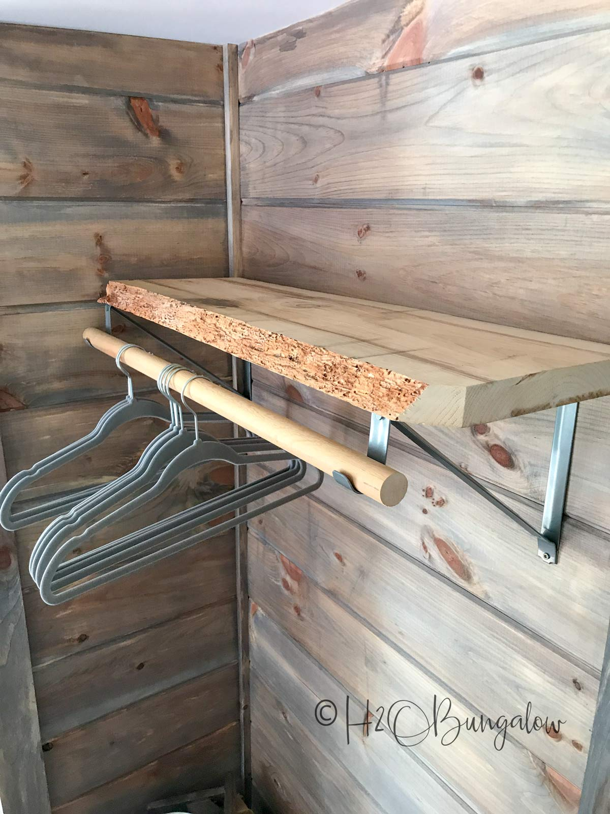 DIY clothes hanging bar with relaimed wood shelf and many more shelf ideas for the home