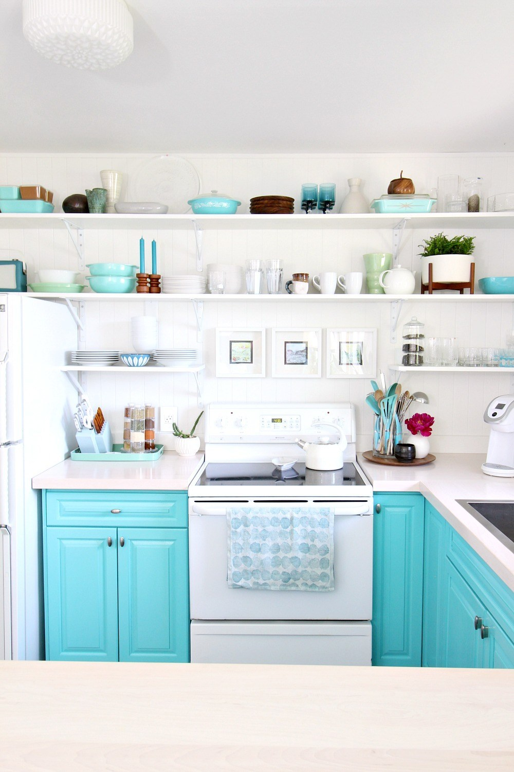 teal and white open kitchen shelves