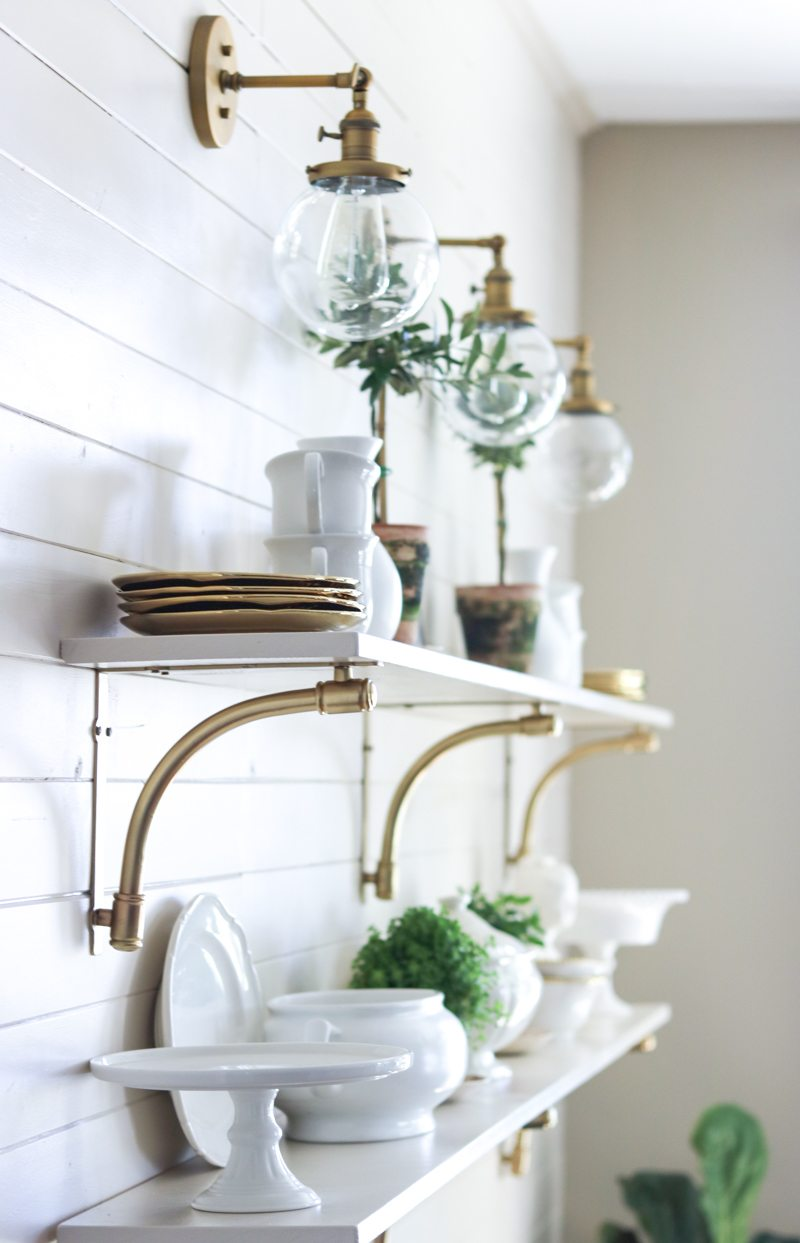 modern gold and white open kitchen shelving