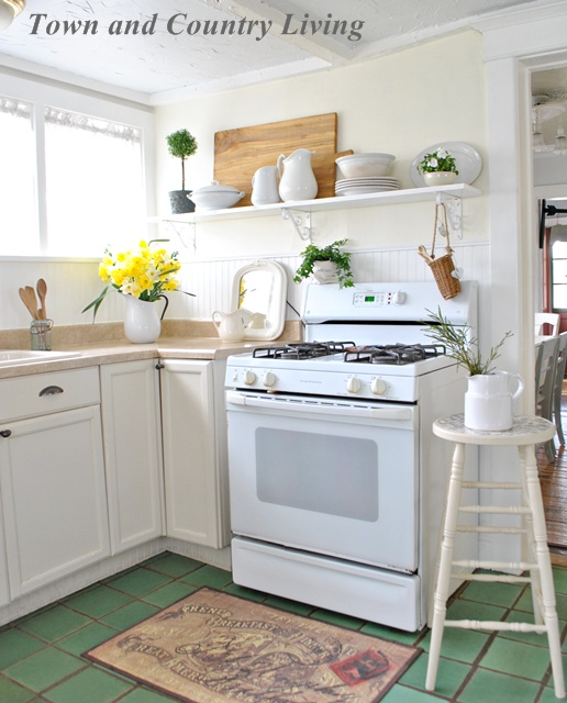 quaint country kitchen with open shelf