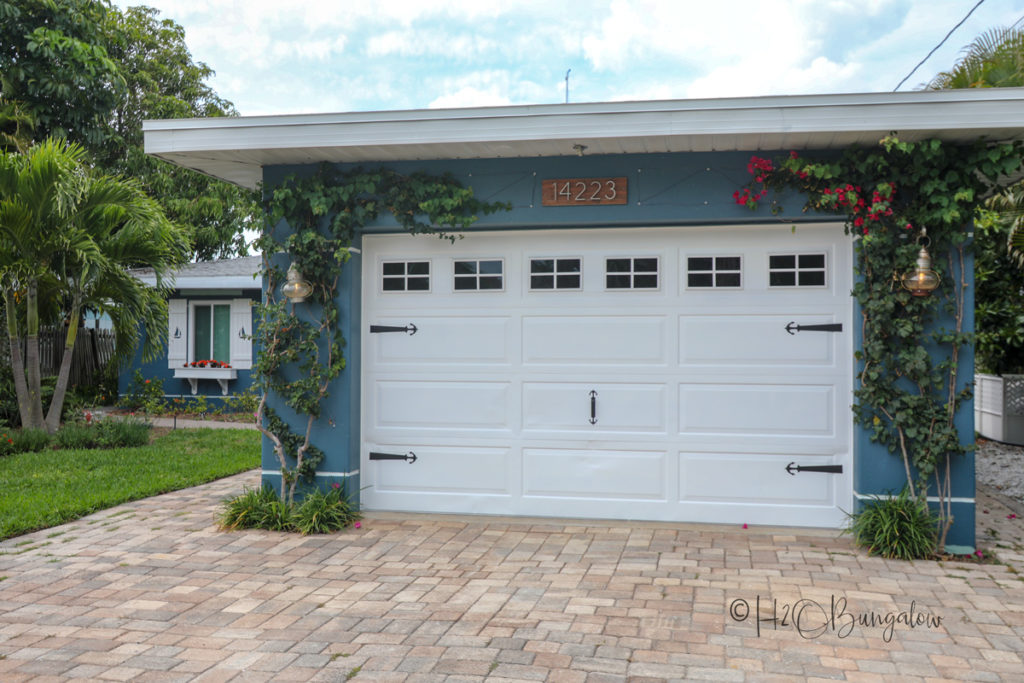 Faux garage windows and front of H2OBungalow coastal home tour