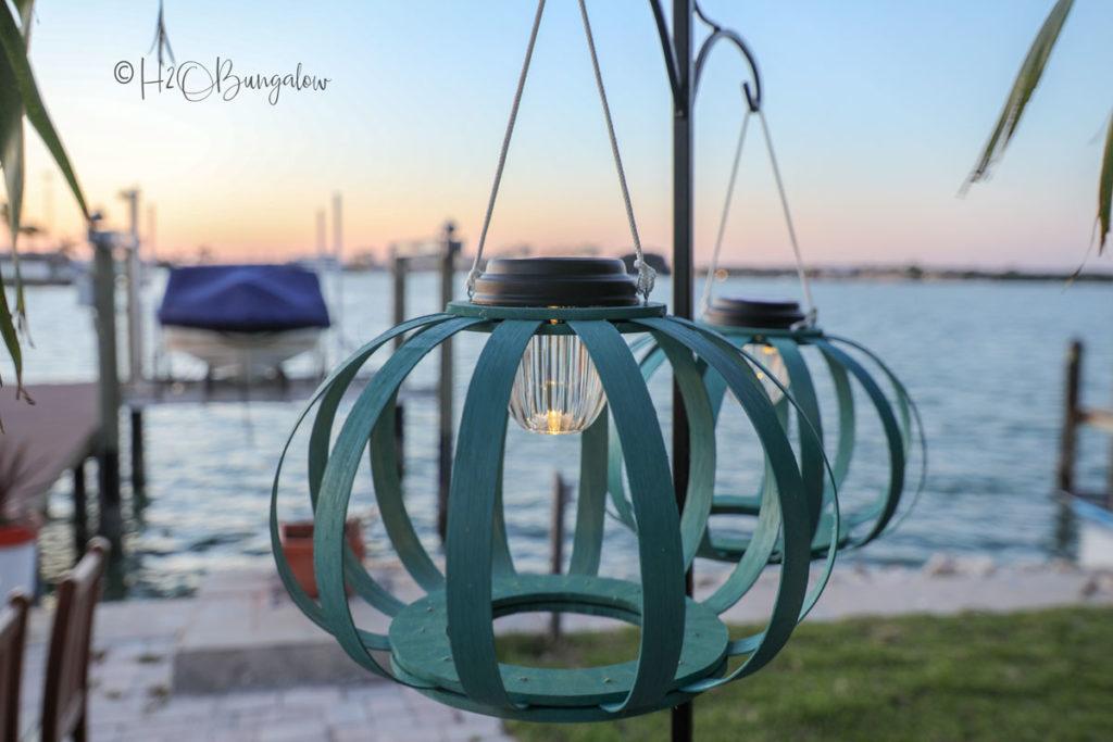 hanging solar lanterns at sunset