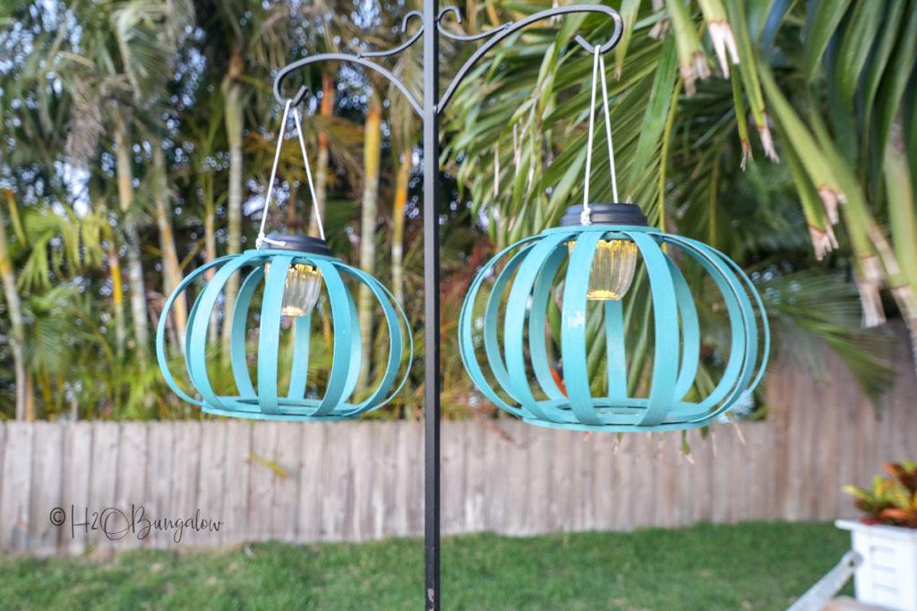blue DIY solar hanging lanterns on shepherds hook