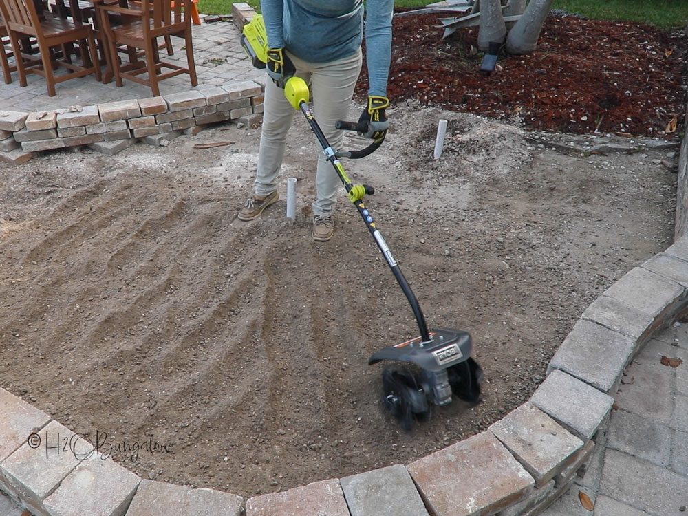 breaking up the soil in new landscape bed
