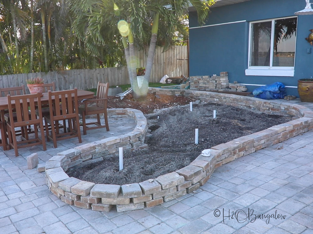 patio landscape bed with stacked pavers for edging