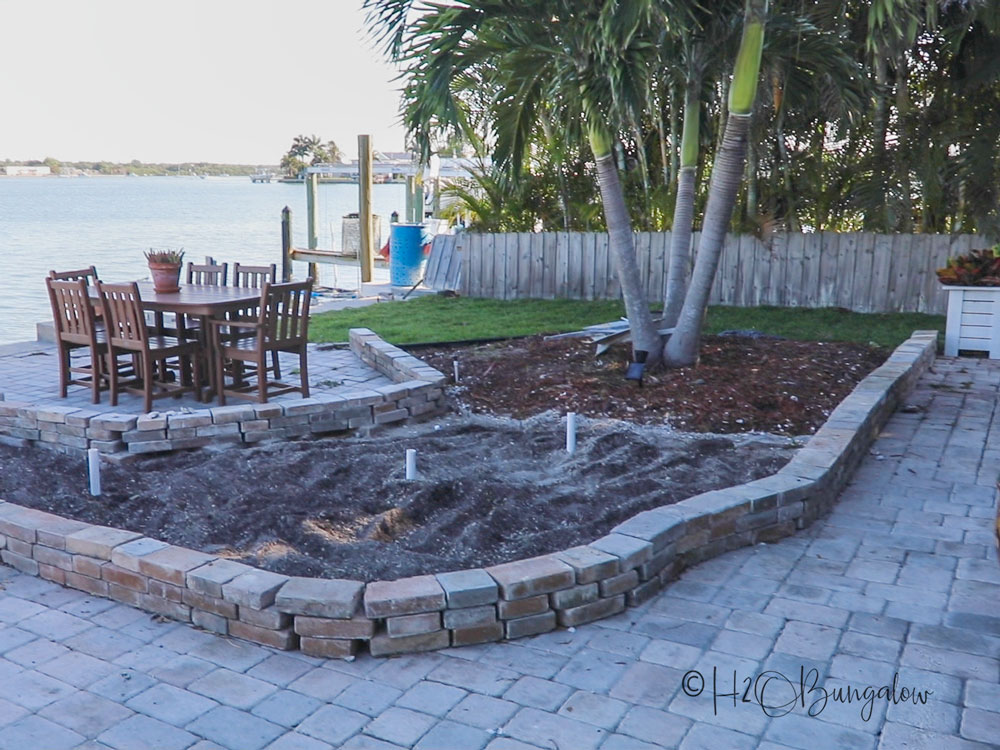 patio garden bed with reusing pavers for garden edging