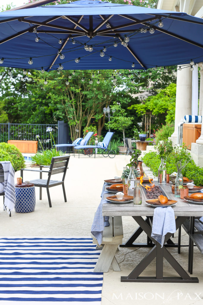 blue poolside outdoor dining area
