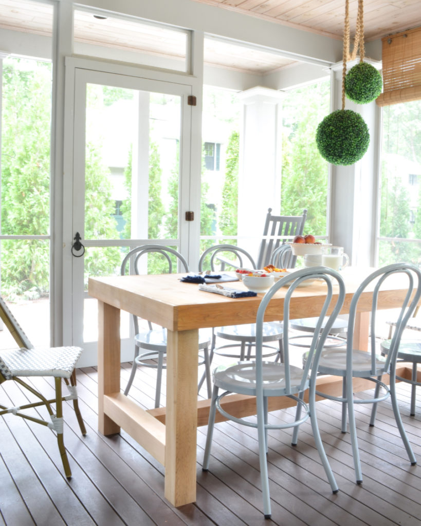 mixed seating at diner table on porch