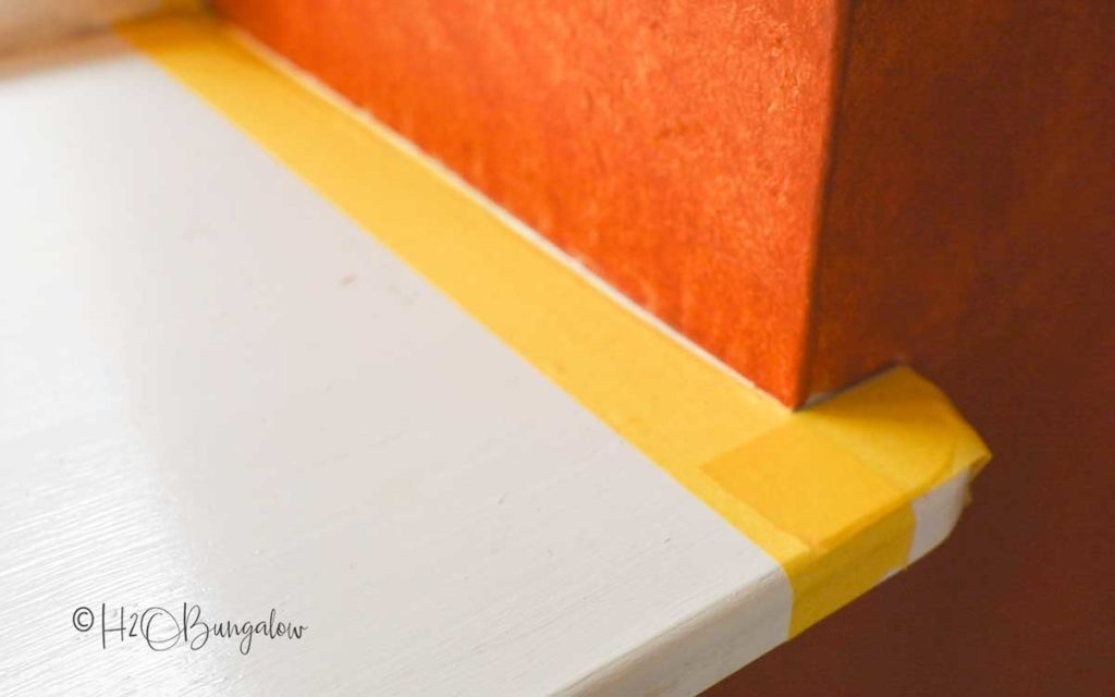 delicate painters tape on window sill