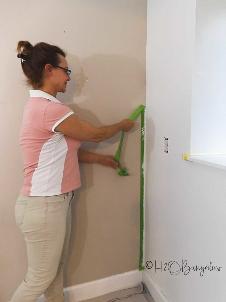 removing painters tape after painting over dark wall paint