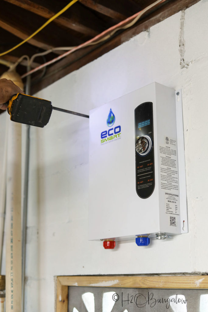 EcoSmart tankless electric water heater on wall