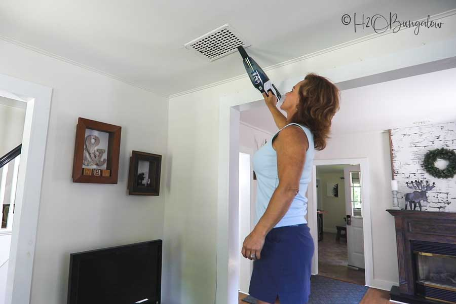 vacuuming ceiling vents deep clean a home