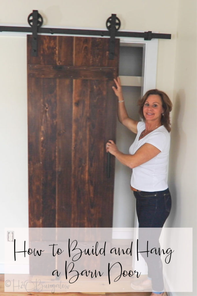 Building a barn door tutorial for beginners. Includes free building plans, Tips on selecting wood, how to build and hang a sliding barn door yourself.