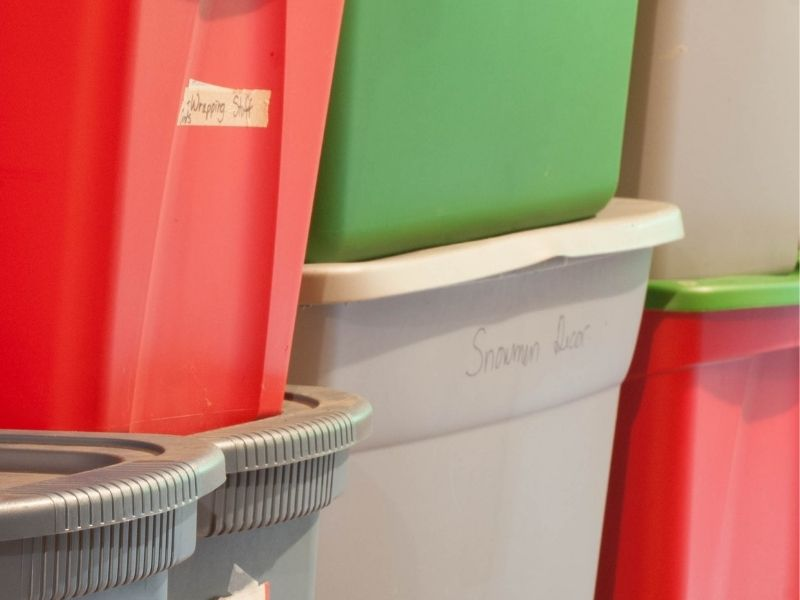 red, green, and gray plastic storage totes stacked