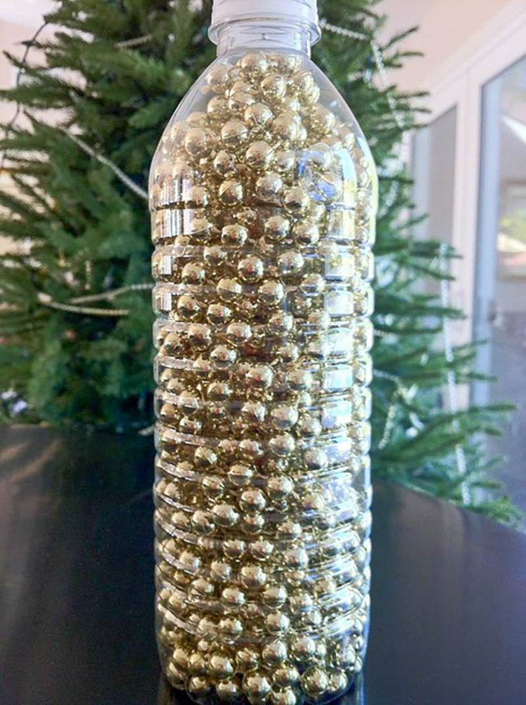 gold sting of bead garland in a plastic bottle