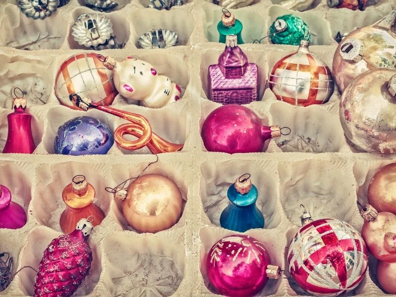 vintage colorful ornaments in an egg carton