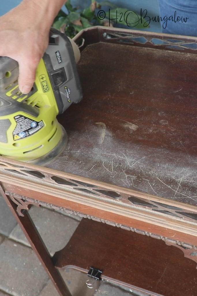 sanding tables to prep for painting over dark stained wood