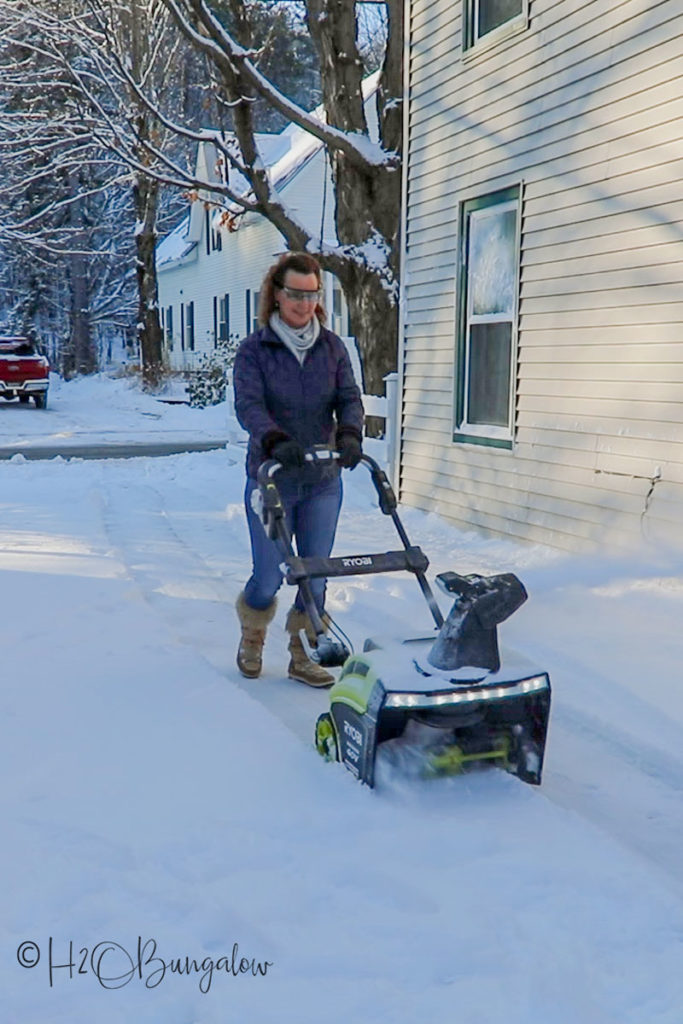 using a snow blower to remove snow
