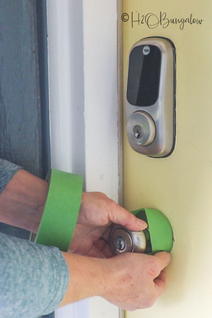 taping off a front door before painting it